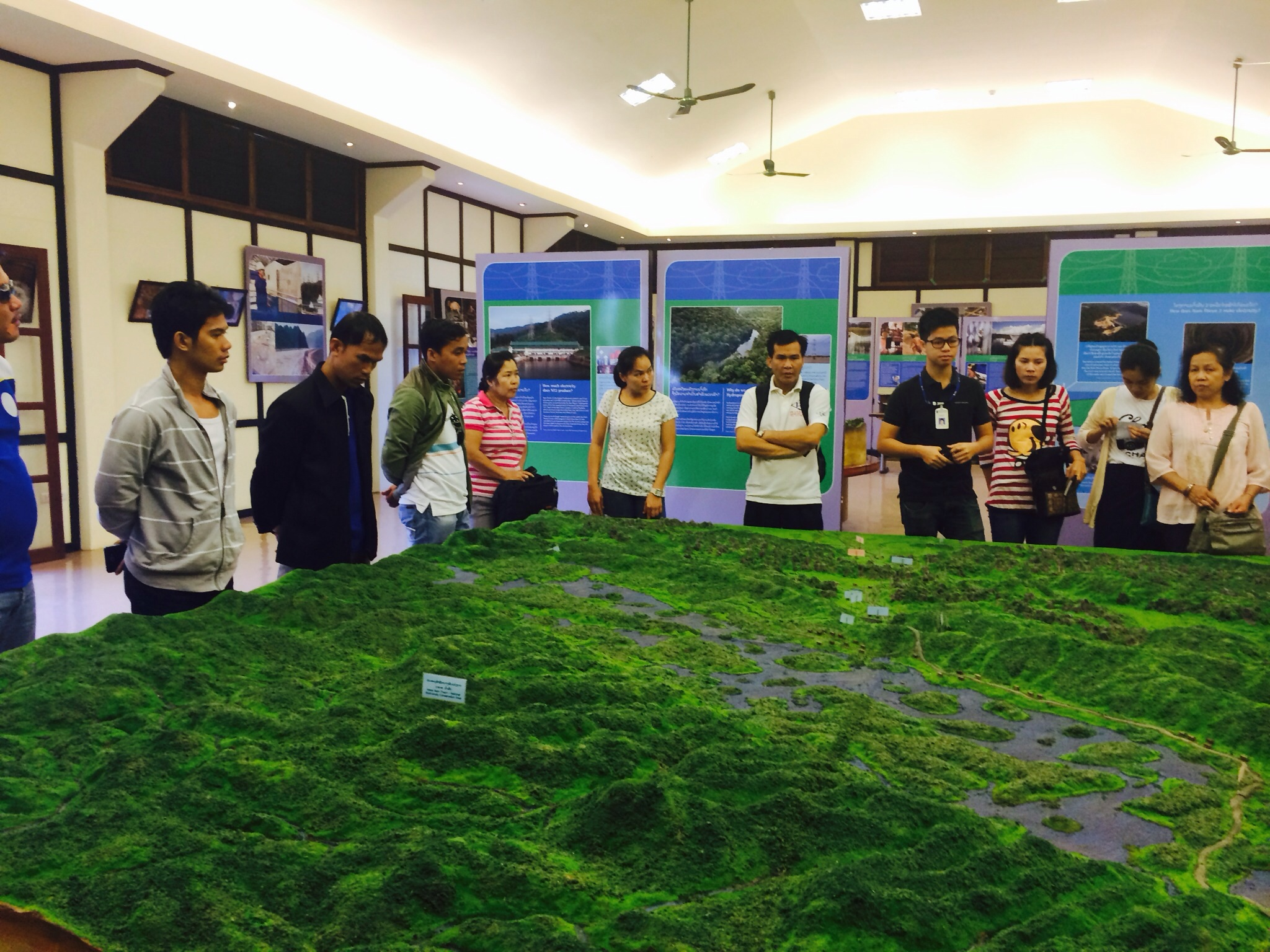 Participants look at the 3D representation of the project